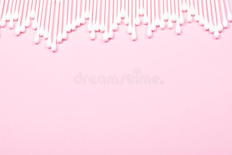 Pattern of cotton swabs on pink background. royalty free stock photos