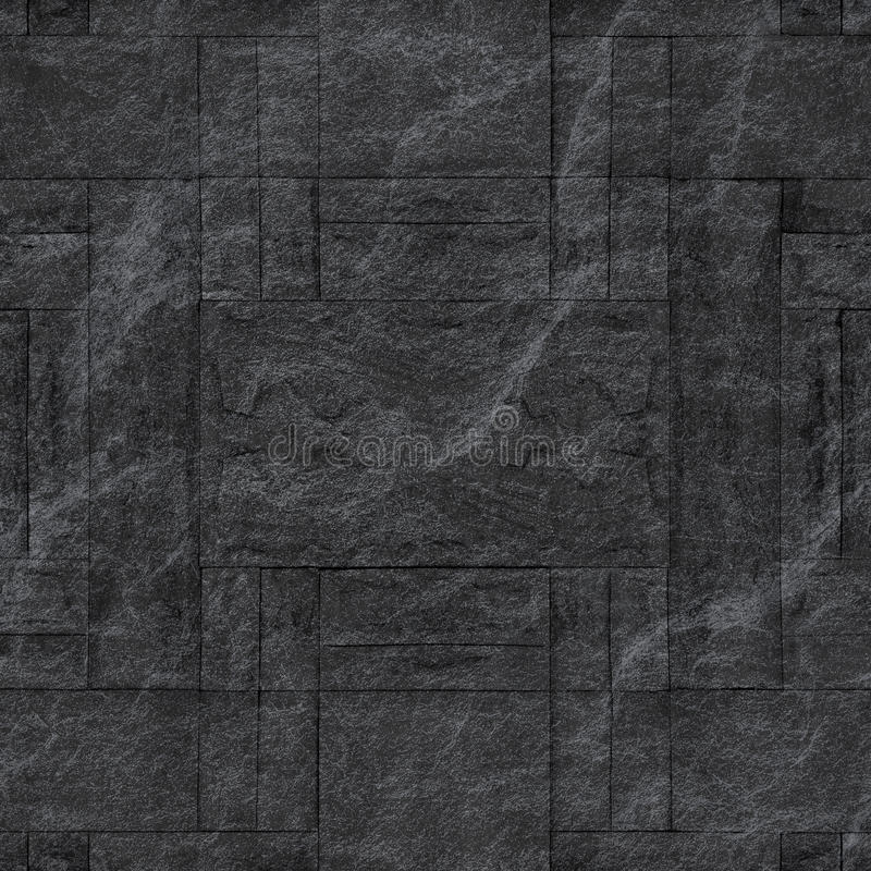 Pattern of decorative black slate stone wall surface. / black stone royalty free stock photo