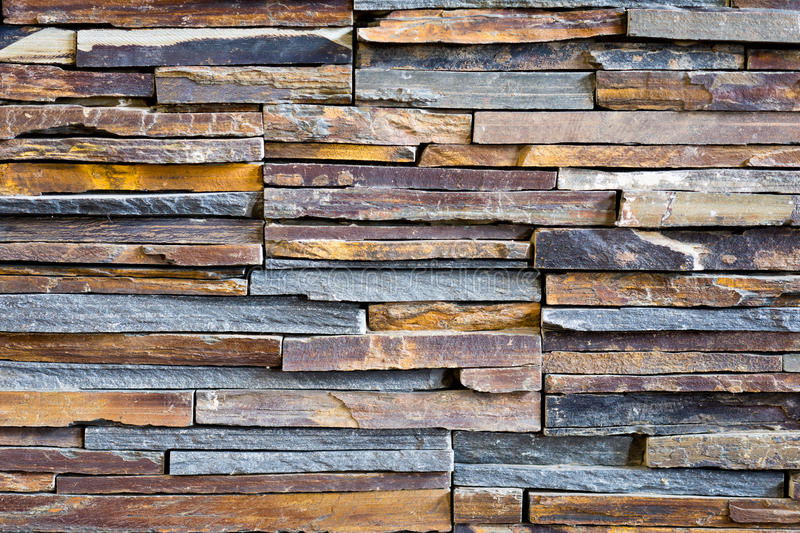 Pattern of decorative slate stone wall background royalty free stock images