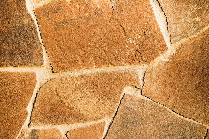 Pattern of decorative slate stone wall surface. Brown color. Close-up royalty free stock photo