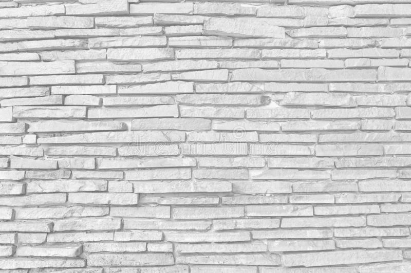 Pattern of decorative white slate stone wall surface. Surface white wall of stone wall gray tones for use as background royalty free stock photos