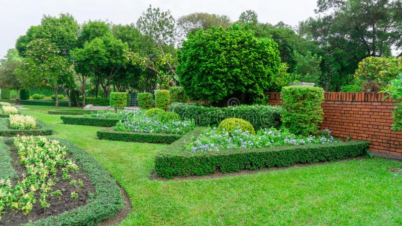 Pattern of English formal garden style, gardens with geometric shape of bush and shrub, decoration with colorful flowering plant stock photography