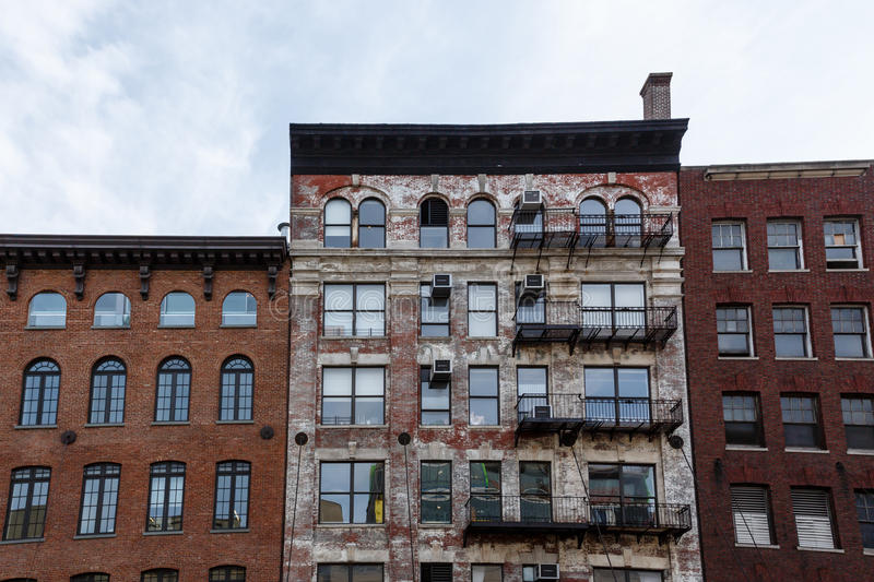 Download Pattern Of Fire Escapes And Window Air Conditioning Units On Side Old Brick Building