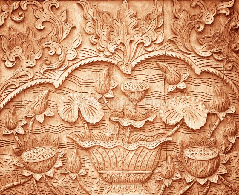 Pattern of flower carved on wood. Background stock image