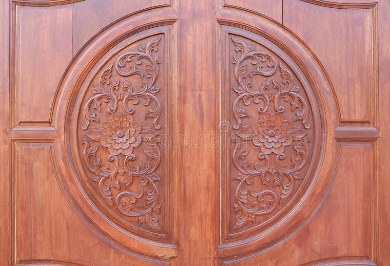 Pattern of flower carved on wood background. royalty free stock images