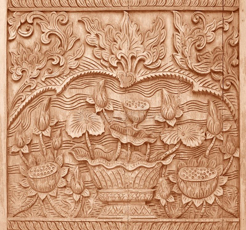 Pattern of flower carved on wood background on the wall of temple Thailand stock photos