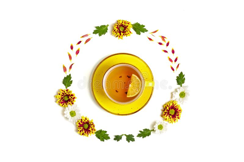 Pattern of flowers of red and white asters, green leaves and yellow cup of hot tea isolated on white background royalty free stock photography