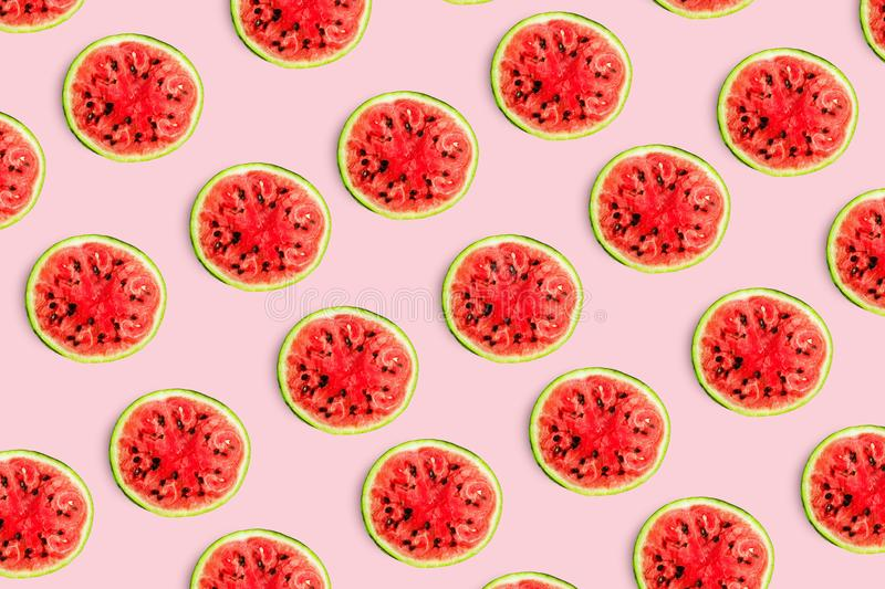 Pattern food background from the pulp of watermelon on a round slice , view from above closeup, stock photos