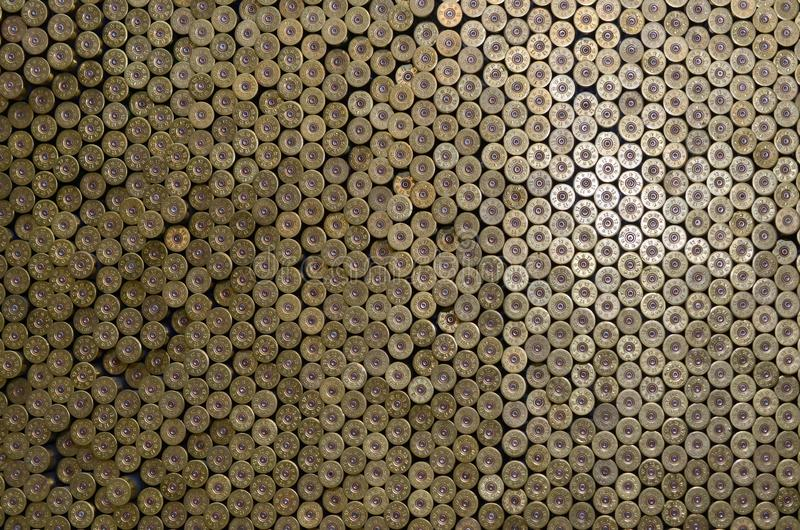 Pattern of 12 gauge cartridges for shotgun bullets. Shells for hunting rifle close up. Backdrop for shooting range or ammunition stock photo