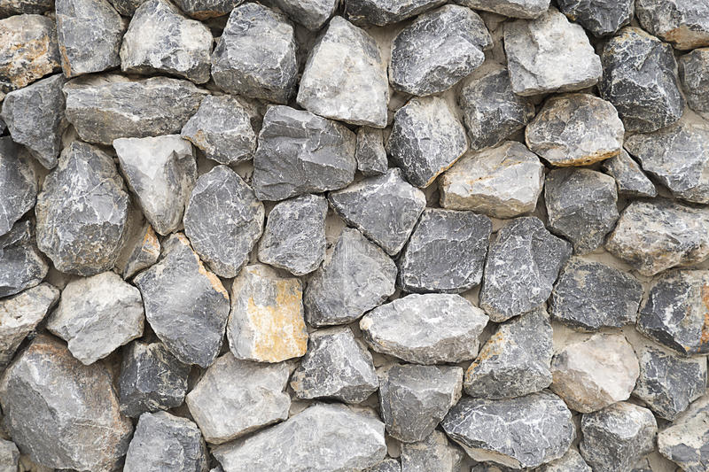 Pattern gray color of modern style design stacked stone wall background, real stone wall surface with cement.  stock photo