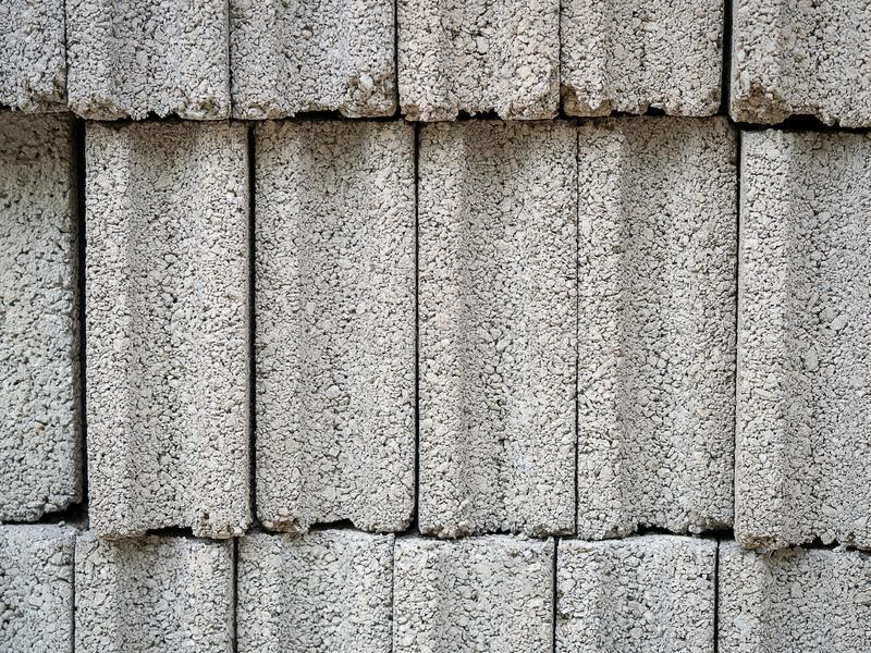 Pattern of grey concrete cement block bricks at  construction site royalty free stock images