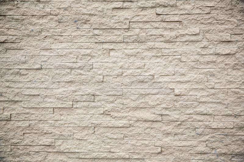 Pattern of grey and rough sandstone wall texture and backgroun, natural surface. Sandstone wall background and texture stock images