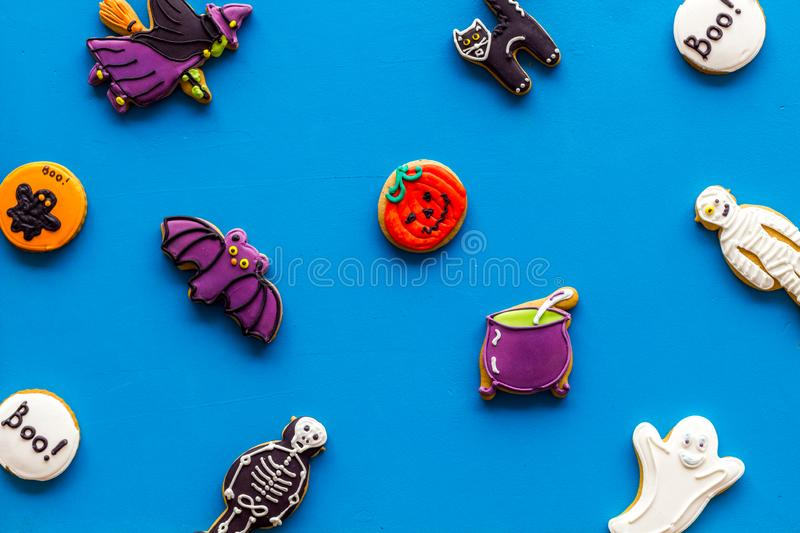 Pattern from halloween figures on blue background top view.  stock photos