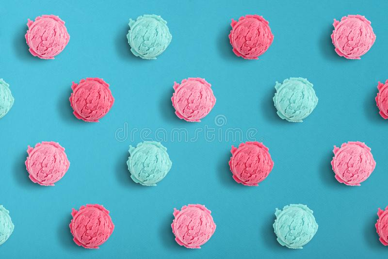 Pattern of ice cream scoops. On the blue background, top view stock photos