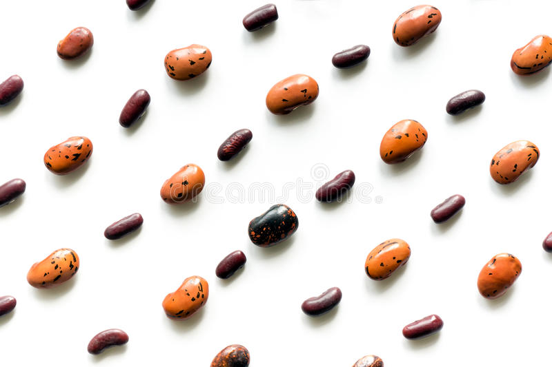 Pattern isolated beans. Simple pattern made of dry beans on white background. Flat lay stock images