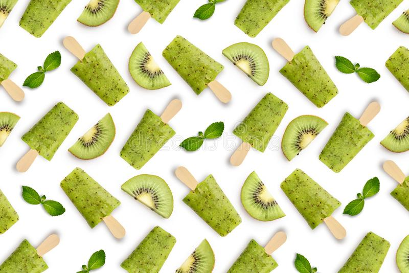 Pattern from kiwi popsicle. Isolated on white background royalty free stock image