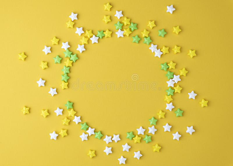 Pattern with Lollipops sweets round copy space. Candy with snowflake, top view flat lay yellow pastel background. royalty free stock photography