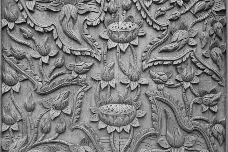 Pattern of lotus flower carved on wood background royalty free stock photo