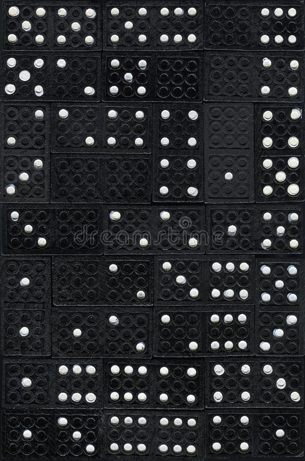 Pattern made from domino stones stock photo