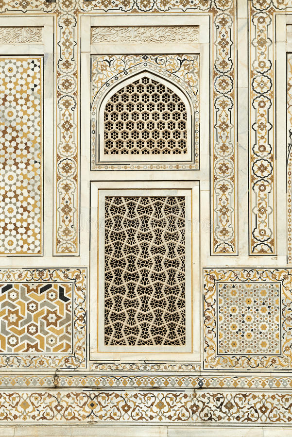 Pattern on marble wall with inlay work. Detail of pattern on marble wall with inlay work surrounding window, Itmad-Ud-Daulah's Tomb or Etimad-ud-Daulah, Agra royalty free stock images