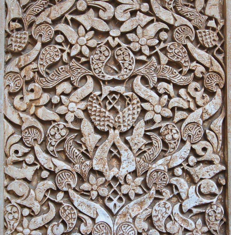 Pattern of medieval arabian art at Alhambra. Granada, Spain royalty free stock photography