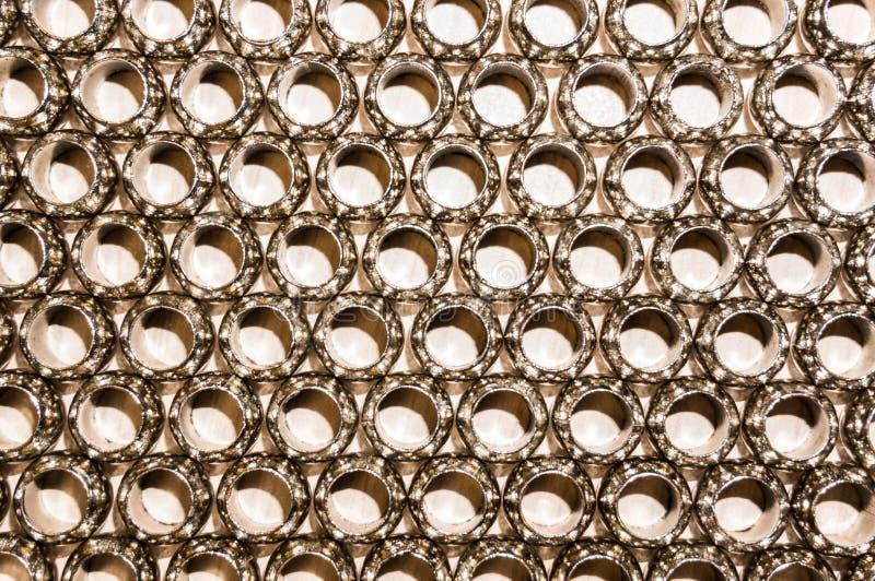 Pattern of metal hoops. Pattern of gold metal hoops stock photos