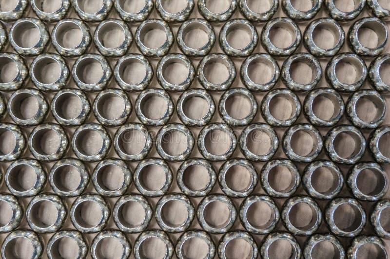 Pattern of metal hoops. Pattern of grey metal hoops stock images