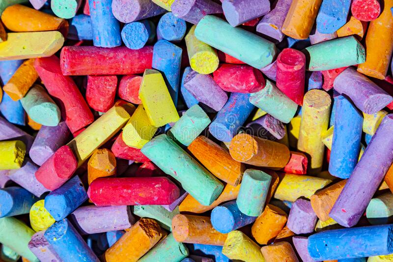 Pattern of mixed colorful chalk pieces stock image