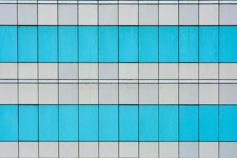 Pattern of modern glass windows building skyscrapers of business center in the city. royalty free stock photography