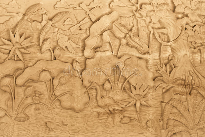 Nature carved on wood. Pattern of nature carved on wood in Bali, Indonesia stock photography