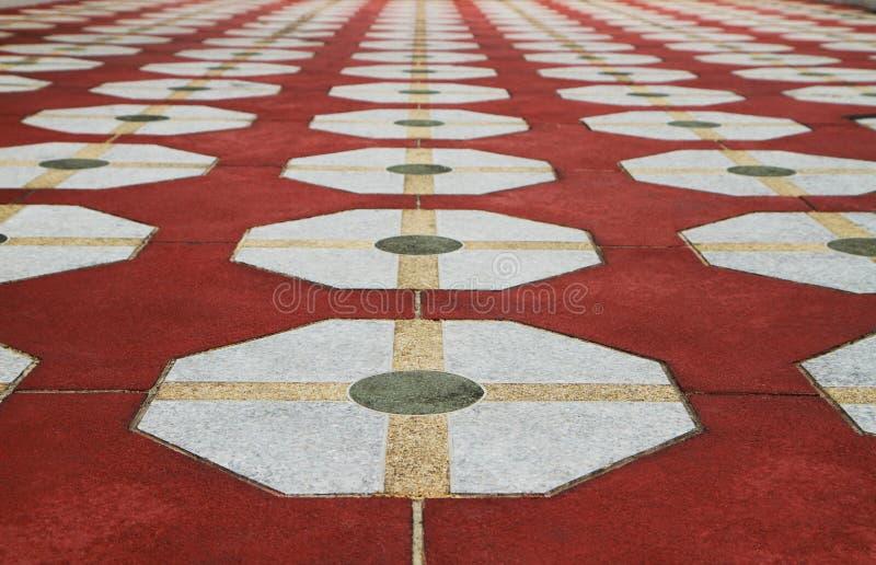 Pattern of octagon granite floor. Pattern of octagon granite on red floor royalty free stock image