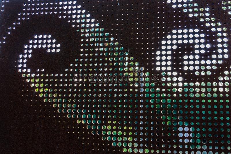 Pattern On Panel 2. A metal outdoor panel has a pattern stock photo