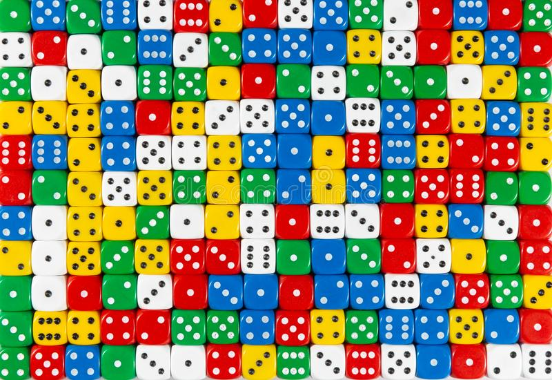 Pattern of random ordered polychrome dices. Pattern background of random ordered red, white, yellow, blue and green dices royalty free stock photo