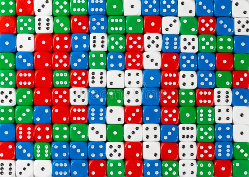 Pattern of random ordered red, white , green and blue dices. Pattern background of random ordered red, white, green and blue dices royalty free stock photography