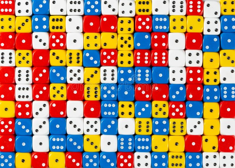 Pattern of random ordered red, white, yellow and blue dices. Pattern background of random ordered red, white, yellow and blue dices royalty free stock photos