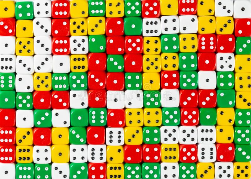 Pattern of random ordered red, white, yellow and green dices. Pattern background of random ordered red, white, yellow and green dices royalty free stock photo