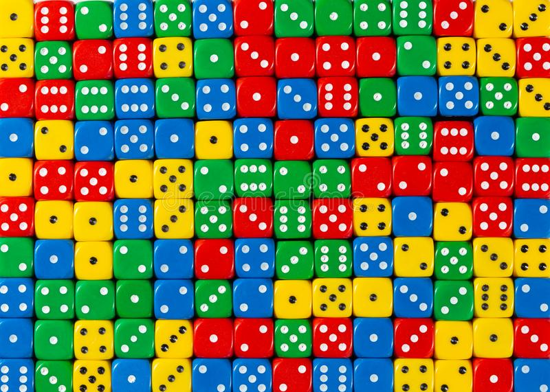Pattern of random ordered red, yellow, green and blue dices. Pattern background of random ordered red, yellow, green and blue dices royalty free stock images