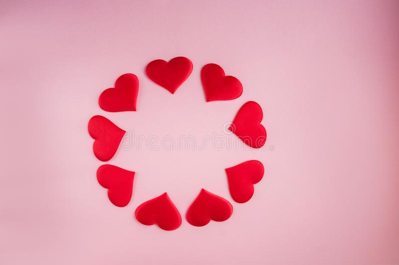 Pattern of red and white hearts on a background. Romantic concept for Valentine`s Day. royalty free stock photos
