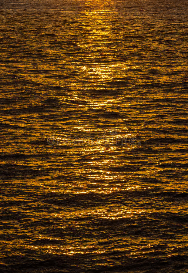 Pattern of ripples in the ocean reflecting sun royalty free stock photography