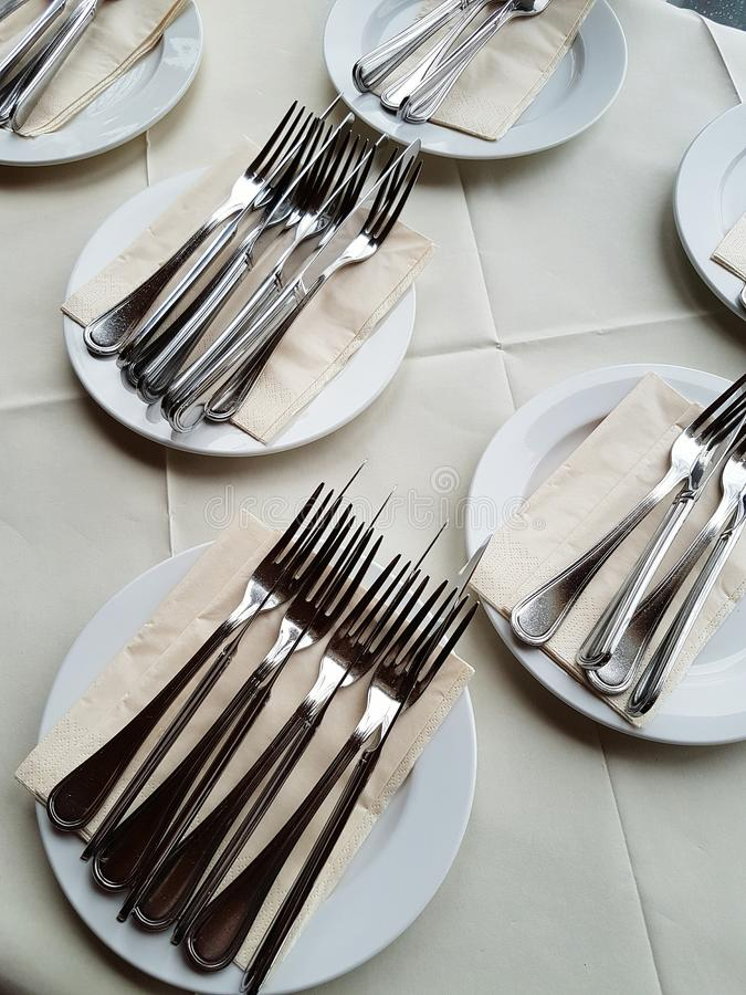 Silver cutlery for luxurious dinner stock photos
