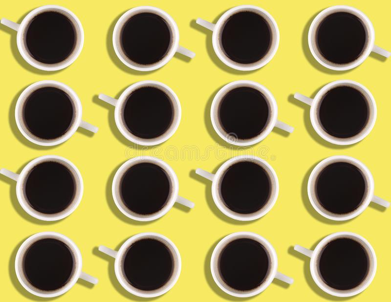 A pattern of small coffee cups on a bright colored background. royalty free stock photography