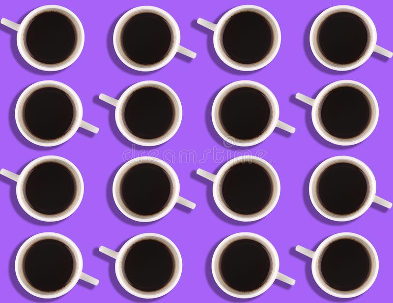 A pattern of small coffee cups on a bright colored background. A pattern of small coffee cups on a bright colored background stock photos