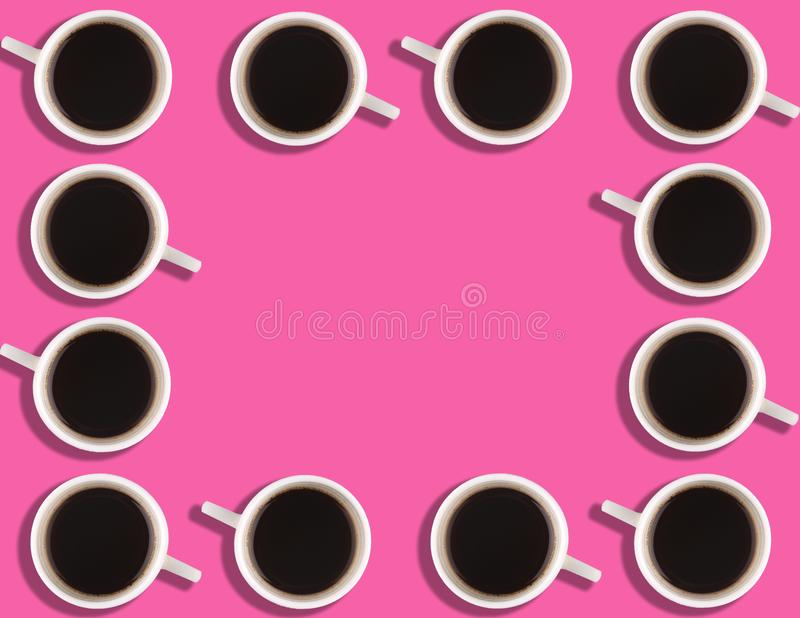 A pattern of small coffee cups on a bright colored background with copyspace.  royalty free stock photography