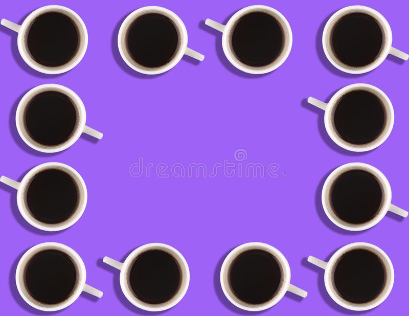 A pattern of small coffee cups on a bright colored background with copyspace.  royalty free stock images