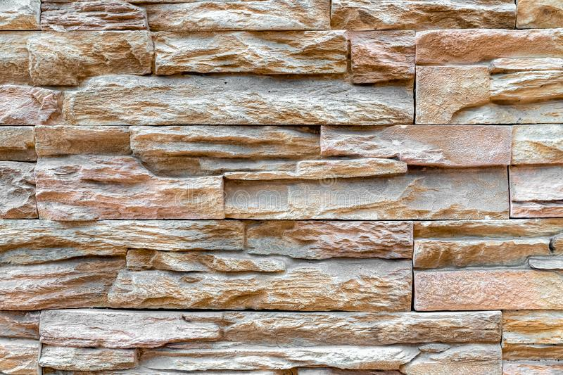 Pattern of stacked stone wall or brick wall texture background. Abstract, aged, architecture, art, backdrop, backgrounds, block, bricks, brickwork, brown royalty free stock photos