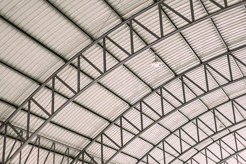 Pattern of steel roof framework, Curve roof steel design structure with galvanized corrugated roofing tile steel sheet stock images