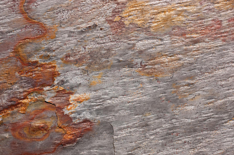 Pattern of a stone slab in silver-gray and rust. Abstract pattern of a stone plate in silver-gray and rust. The slab is part of a wall covering in La Gomera royalty free stock photography