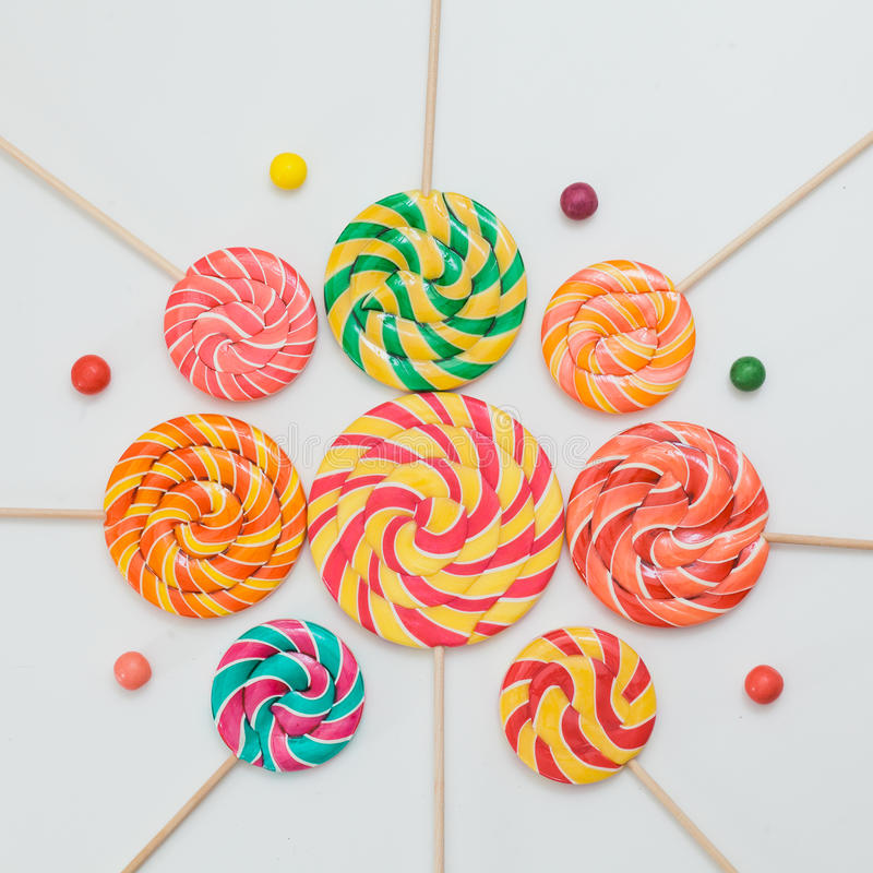 Pattern sweet lollipops, candy on white background, top view fla stock image