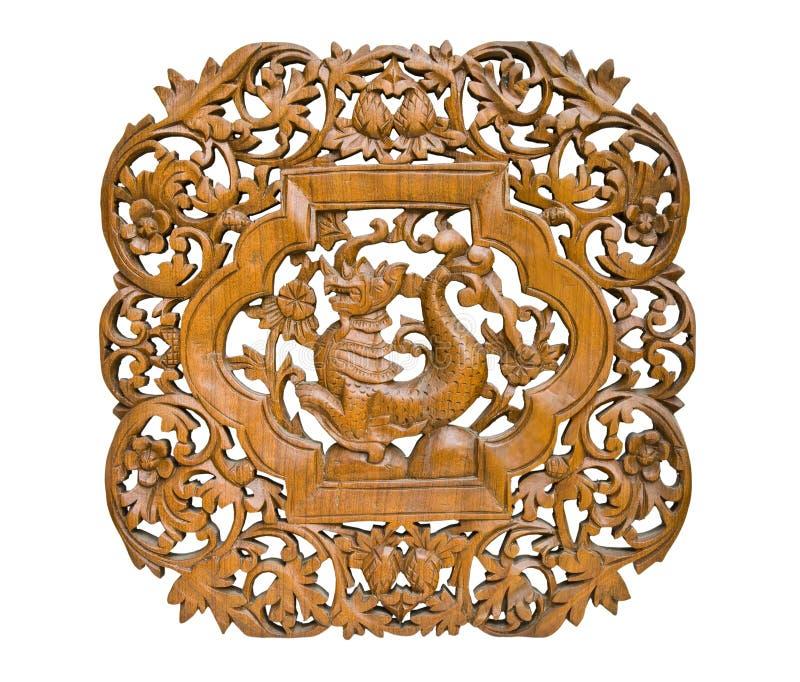 Pattern Thai art carving on wood, King of Nagas royalty free stock photo