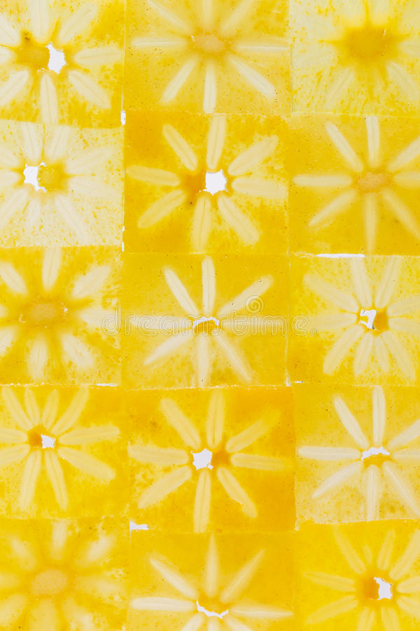 Pattern of thin slices of persimmon. Pattern of thin pieces of bright orange persimmon royalty free stock images